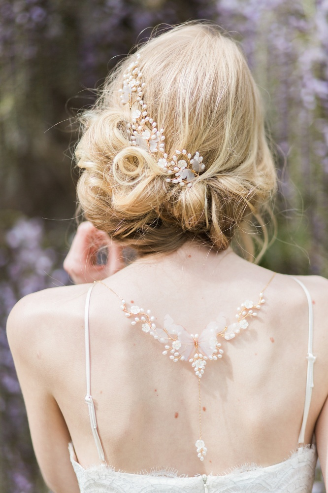 Image of pearl back necklace with butterflies - click to view